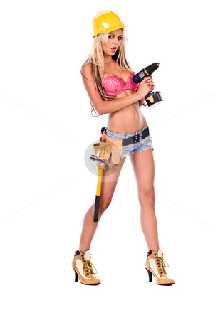 Sexy Construction Worker stock photo, High fashion glamour model in daisy duke shorts, tool belt, pink bra and yellow hard hat on a ladder aiming a screw gun by Robert Deal