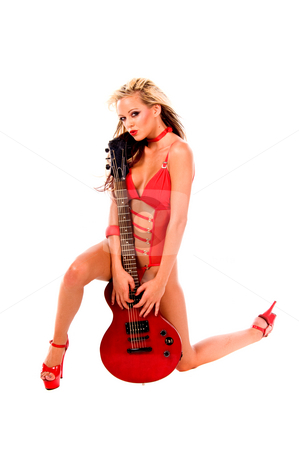 Rock N Roll chick stock photo, Sexy young blonde lingerie model in a red one piece and red high heels with a red Les Paul style electric guitar by Robert Deal