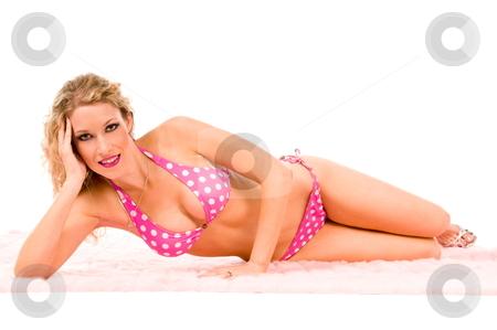 Sexy woman in pink bikini. stock photo, Sexy blond wearing a pink polka dot bikini laying on a the floor. by Robert Deal