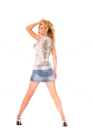 Beautiful blond woman. stock photo, Back view of a woman wearing a short denim skirt and a t-shirt with wings on the back. by Robert Deal