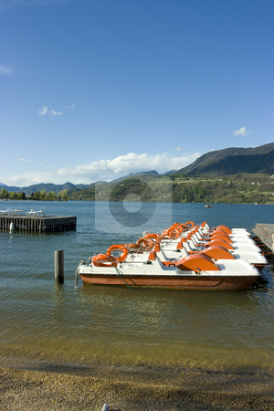 Catamarans on Caldonazzo lake stock photo, Row of colorful catamarans with buoys on Italian Caldonazzo lake near Trento by Natalia Macheda