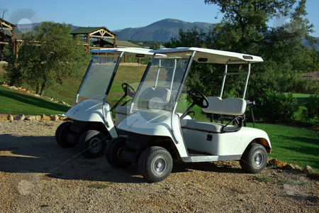 Golf carts stock photo, Two carts in golf club early morning by Natalia Macheda