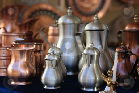 Coppery utensils stock photo, Jugs and pans of copper and aluminium in assortment on market by Natalia Macheda