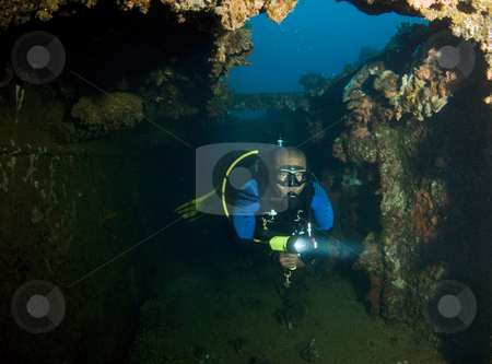 Diver Exploring Wreck stock photo, A recreational diver explores a passenger liner turned Japanese submarine tender during World War II. The Rio De Janeiro Maru was sunk during Operation Hailstone, February 1944, in Truk (Chuuk) Lagoon, Micronesia by A Cotton Photo