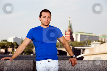 Russian man standing on the streets stock photo, Russian man standing on the streets of Moscow by Vitaly Sokolovskiy