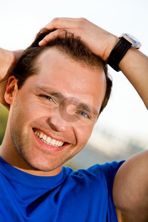 Smiling man outdoors stock photo, Portrait of smiling caucasian man outdoors by Vitaly Sokolovskiy