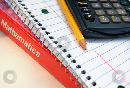 Math Class Items stock photo, A math book, notebook, calculator, and pencil still life. by Crystal Srock