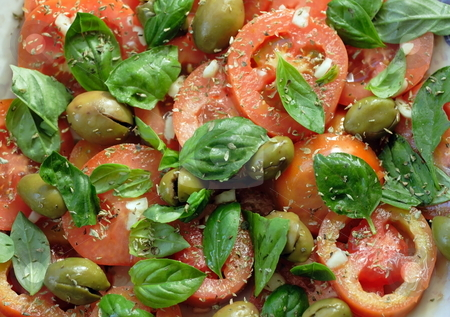 Italian salad stock photo, Typical salad of Southern Italy: tomatoes, basil torn manually, garlic, dry oregano, and pressed green olives by Natalia Macheda