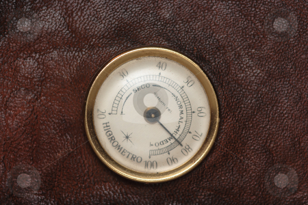Hydrometer stock photo, Old hydrometer on a leather case for cigars by Natalia Macheda