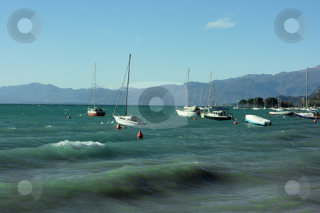 Lake Garda stock photo, Lake Garda with boats and mountains on horizon by Natalia Macheda