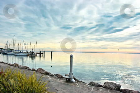 Sunset over lake Garda stock photo, Drammatic sunset over lake Garda renders colors pastel and scene serene by Natalia Macheda