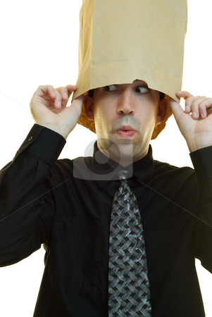 Businessman Hiding stock photo, A young businessman hiding his head in a paper bag by Richard Nelson