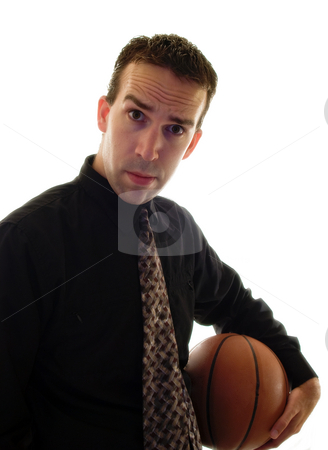Corporate Sports stock photo, A young man wearing a suit and tie holding a basketball by Richard Nelson