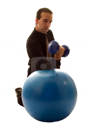 Businessman Relieving Stress stock photo, Businessman using a yoga ball and weights to help relieve stress by Richard Nelson
