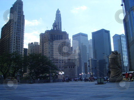 Some of Chicago's Building's  stock photo, A picture of some of the building/ sky scrapers in Chicago, also with one of the many statues of chicago on the far right of the photo. by David Robinson