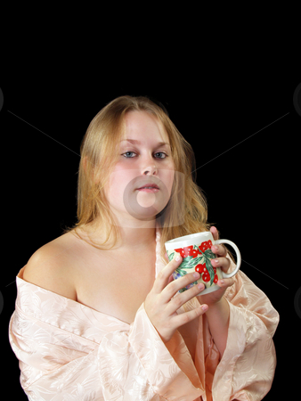Woman in robe stock photo, Young woman in peach robe with coffee or tea cup by Jeff Cleveland