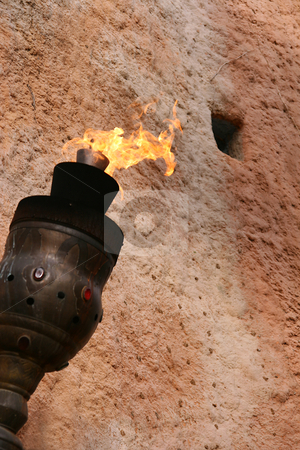 Antique medieval torch stock photo, Medieval torch on a wall by Tilo