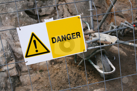 Danger sign stock photo, Warning sign in front of a construction zone by Tilo