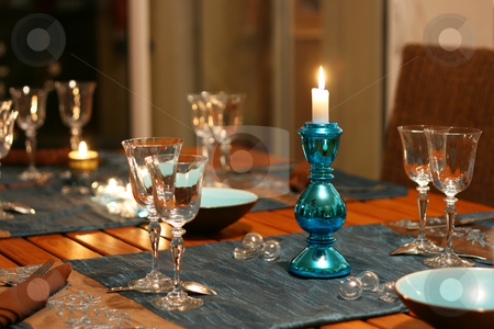 Celebration table stock photo, Warm celebration table, focus on candlestick by Tilo