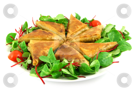 Samosas on a plate stock photo, Samosas and salad on a plate, isolated on white by Tilo