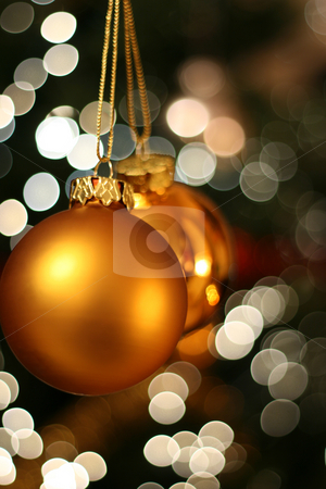 Christmas golden ball stock photo, Christmas golden ball with a light blur creating bokeh in the background by Tilo