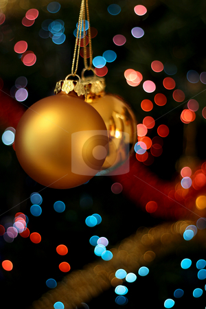 Christmas golden balls stock photo, Christmas golden ball with a light blur creating bokeh in the background by Tilo