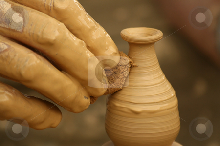 Potter's fingers stock photo, Close-up of fingers making pottery on a wheel by Tilo