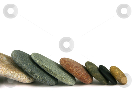 Seven pebbles line stock photo, Seven pebbles in line, over white by Tilo