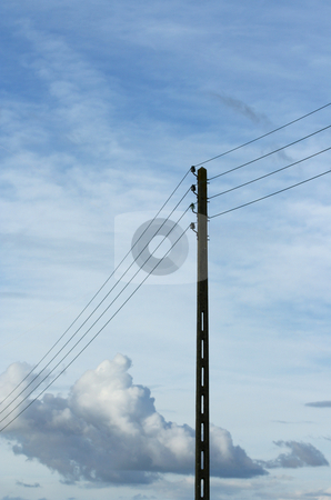 Power lines stock photo, Power pole on a blue sky background by Tilo