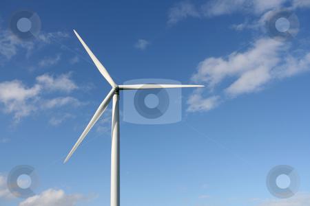 Wind turbine stock photo, Wind turbines in a field over a blue sky. by Tilo