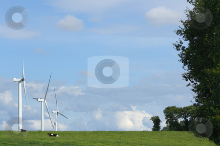 Clean power stock photo, Landscape with three windmills in the countryside by Tilo