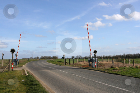 Railroad crossing stock photo, Railway level crossing in the country by Tilo