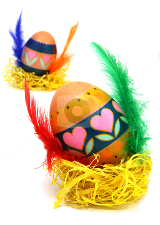 Measter egg stock photo, Easter egg race. Wings made of color feathers. Isolated on white. by Laurent Renault
