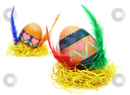 Measter egg stock photo, Easter egg race. Wings made of color feathers. Isolated on white. by Tilo