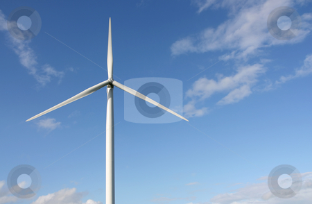 Wind turbine stock photo, Wind turbines in a field with blue sky background by Tilo