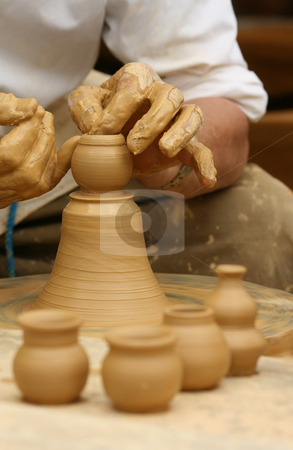 Potter's art stock photo, Close-up of hands making pottery on a wheel by Tilo