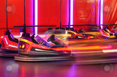 Bumper cars stock photo, Bumper cars in motion in amusement park by Tilo