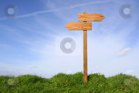 Which direction ? stock photo, Wooden direction sign in grass, clipping path included by Tilo