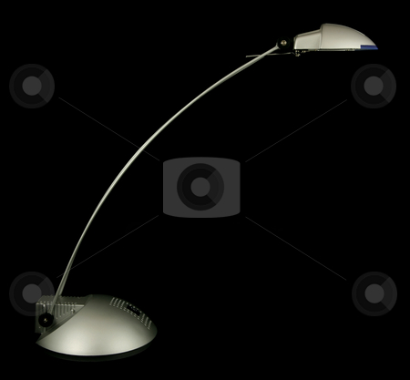 Halogen desk lamp stock photo, Halogen desk lamp isolated on black by Tilo