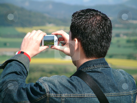 Taking a picture stock photo, Asian man taking a picture by Tilo