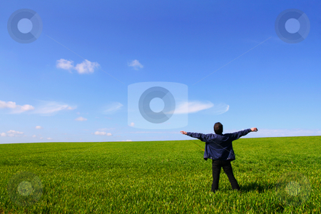 Air breathing stock photo, A man alone in a green field, breathing the air with open arms by Tilo