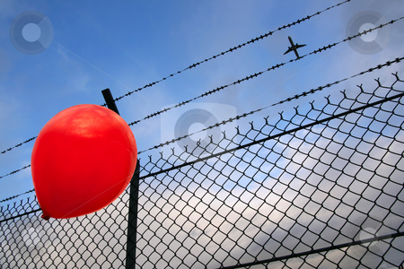 Barbed freedom  stock photo, A red balloon in danger by Tilo