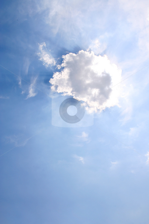 Sunrays stock photo, Sun hidding under a tiny cloud by Tilo