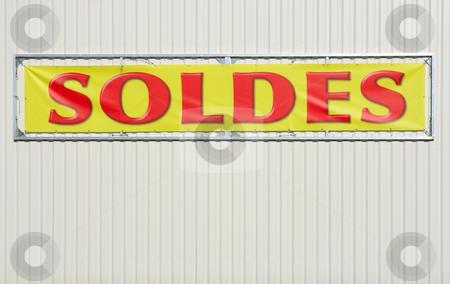 Soldes stock photo, Affiche annon?ant les soldes d'un magasin, accroch?e sur la t?le d'un entrep?t by Tilo