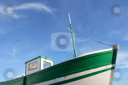 Fishing boat stock photo, Green old fishing boat, under a blue sky by Tilo