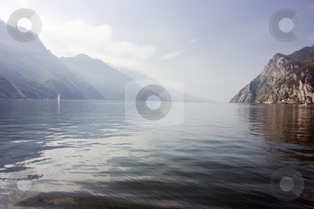 Lago di Garda stock photo, Amazing scenerey of Garda Lake with mountains embracing water. by Natalia Macheda