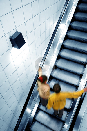 Escalator, blue stock photo, Couple moving on escalator, with motion blur by Tilo