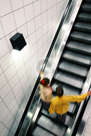 Escalator, grey stock photo, Couple moving on escalator, with motion blur by Tilo