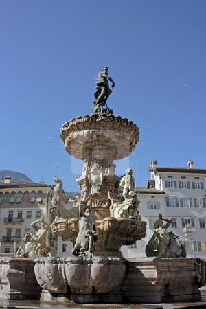 Nettuno di Trento stock photo, The main square (piazza Duomo) of Trento (Italy) with a fountain as Neptune holding a trident. Anciet buildings are on the background by Natalia Macheda