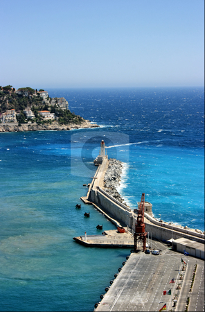 Nizza lighthouse stock photo, Lighthouse among azure waves of French Riviera (Nice city) by Natalia Macheda